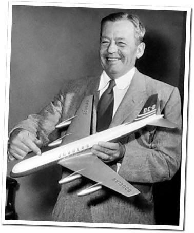 Donald W. Douglas holding a prototype model of the DC-8, circa 1955