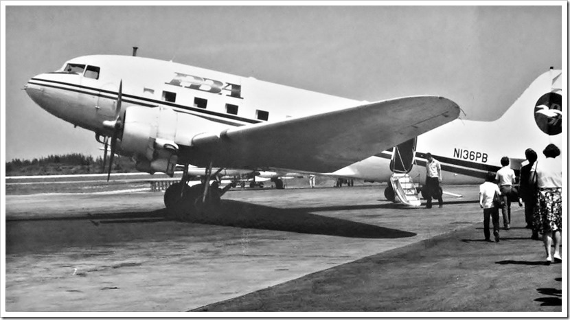 Passengers boarding a DC-3 in 1957